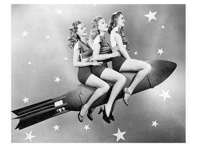 three-women-sitting-on-rocket